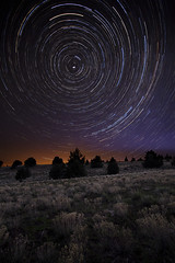 Polaris, All Night Long:  Eastern Oregon (Ivan Sohrakoff) Tags: ranch longexposure nightphotography sky monument night clouds oregon sunrise stars landscape nighttime astrophotography highdesert april astronomy grasses stacking juniper startrails polaris starlight easternoregon landscapephotography nighttimephotography oregonlandscape oregonnight bunchgrasses monumentoregon ivansohrakoff