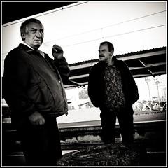 The Smoker (Pigon (Piotr Golebiowski)) Tags: man standing streetphotography rail smoking warsaw warszawa ep1