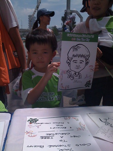 caricature live sketching for Cold Storage Kids Run 2010 - 25