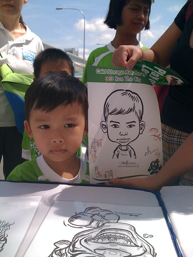caricature live sketching for Cold Storage Kids Run 2010 - 22