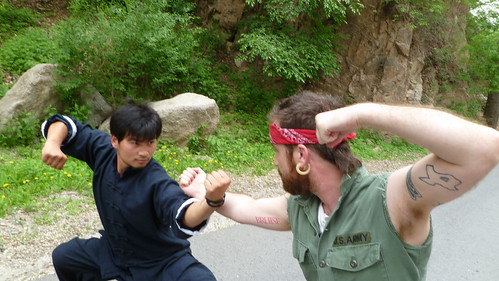 Chuck Norris (@kk) vs Bruce (Lee) at Great Wall. #GOAP