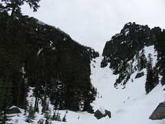 Entering the snow basin. Climbing groups can be seen kicking steps for us &#58:) up the gully toward the notch.