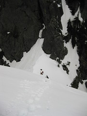 Looking back down the steep snow pitch to the notch.