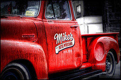 Mike's Auto Wrecking (Clayton Perry Photoworks) Tags: auto old red canada classic chevrolet rain weather vancouver truck canon bc britishcolumbia parking rusty lot 1954 mikes casino richmond chevy crusty hdr pouring riverrock wrecking luluisland claytonperry mikesautowrecking