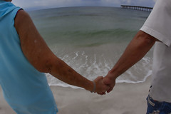 Holding Hands - Saying Goodbye (Mona Hura) Tags: florida holdinghands pensacolabeach sayinggoodbye 9436