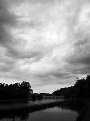 Si prepara a piovere (misterdami) Tags: leica bw white black alberi ticino italia nuvole barche piemonte maddalena acqua bianco lombardia nero canale bosco naviglio diga abbandono elmarit chiusa villoresi archeologiaindustriale ingranaggi sommalombardo navigazione quattroterzi panperduto digilux3 altomilanese scorcibn