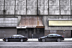 [a street in detroit] (kylepost photography) Tags: road roof reflection cars composition pattern shapes storefront repetition parkingmeter detroitmichiganunitedstateshdrtexture