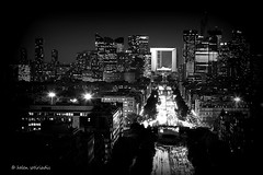 from l'arc de triomphe to la dfense (helen sotiriadis) Tags: street city bw white black paris france monochrome car skyline architecture night canon landscape lights published cityscape trails ladfense larcdetriomphe canonef100mmf28macrousm canoneos40d