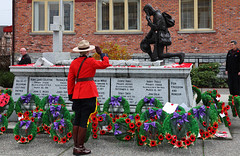 Remembrance Day,  11 November 2010, Museum Square, Surrey BC (PhotoDG) Tags: people canada museum vancouver square soldier bc britishcolumbia canadian surrey wreath poppy rcmp remembranceday cenotaph remembrance veteran cloverdale worldwar iso1600 lestweforget museumsquare ef24105mmf4lisusm remembrancedayservice eos5dmarkii 11november2010