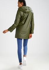 Borg - green raincoat back (ShinyNylonFan) Tags: borg raincoat jeans