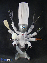 ChefBot: robot chef and cyber cook (Scottoons) Tags: eye utensils kitchen hat scott robot wooden hands junk baker pants handmade assemblage buttons mixer knife cook fork spoon cyclops toque jacket chef octopus blender tongs cyborg recycle android droid cyber sewn whisk houndstooth beater rivet reuse octo pleated sleeves sauer handbuilt chefbot scottoons