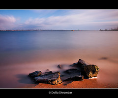 A Rocking View (DolliaSH) Tags: ocean longexposure light sunset sea sky sun seascape color beach water colors clouds strand sunrise canon atardecer lights topf50 rocks 110 smooth surreal paisaje explore le nd topf150 topf100 frontpage 1755 3000views canonefs1755f28isusm nd110 canoneos50d bwpolarizer nd10 platinumphoto theunforgettablepictures platinumsuperstar dollia 100commentgroup sheombar dolliash bw10stopsolidndfilter