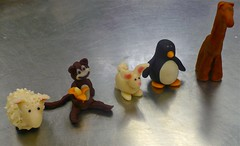 french culinary institute pastry program, day 75: marzipan figurines (pellet13) Tags: nyc rabbit bunny penguin monkey sheep marzipan giraffe frenchculinaryinstitute pastryschool