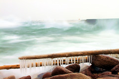 Lake Superior Ice Forms (PhotoYoop) Tags: longexposure winter cold ice nature water canon landscape frozen cool fantastic rocks waves artistic top michigan unique oneofakind awesome rad stock over snowstorm shoreline creative windy best professional formation glorious driftwood wash shore freeze icicle form neat upperpeninsula tops lakesuperior washing marquette thebest breakwall thegreatoutdoors blizzrd professionalphotography digitalmedia genovese bestpics godscreation bestphotos topshots topphotos stockimagery michiganoutdoors thebestphotosonflickr welcometomichigan picturesofmichigan puremichigan alltimebest t1i photoyoop selftaughtprofessional