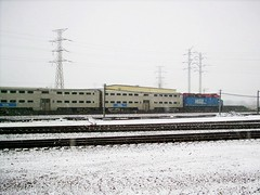 A westbound Metra commuter train passes by during a morning snowstorm. Chicago Illinois. December 2007.