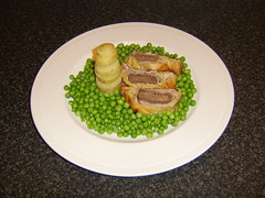 Beef Wellington with Potato and Parsnip Tower and Peas