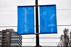 Olympics flags popping up around the city