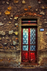 What's behind the red door? (JoLoLog) Tags: door red italy reddoor tuscany oldworld lorien iano canonxsi