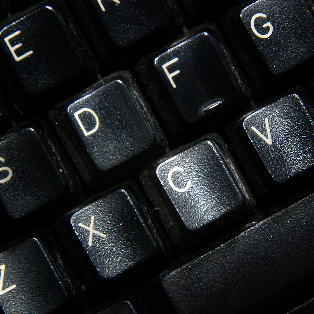 Detail of a keyboard with the letters D and C emphasized.