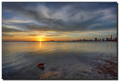 Mr. Conch Makes His First Appearance in 2010 (Fraggle Red) Tags: ocean sunset sun water skyline clouds evening florida shell jpeg canonef1740mmf4lusm hdr brickell keybiscayne biscaynebay conchshell virginiakey 6exp rickenbackercswy anawesomeshot miamidadeco dphdr mrconch