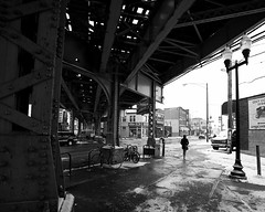 (Cycle the Ghost Round) Tags: city winter urban blackandwhite bw woman usa snow chicago wet girl metal illinois support day afternoon cta blueline unitedstatesofamerica el structure l logansquare solitary beams bracing canoneos5d canonef1635mmf28lusm