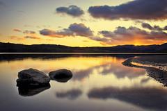 Loch Venachar (Stuart Stevenson) Tags: sunset water scotland still rocks canon300d peaceful calm shore stirlingshire thetrossachs lochvenachar stuartstevenson oneofthelastimagestakenwithmy300d andyesiwasinthelochtogetthispic glenoftranquility lochvenacharisafreshwaterlochinstirlingshirescotland