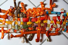 408: Fabric Ficklesticks (enovember) Tags: sculpture orange sticks pipe cleaner weaving weave fabic dianataylor ficklesticks