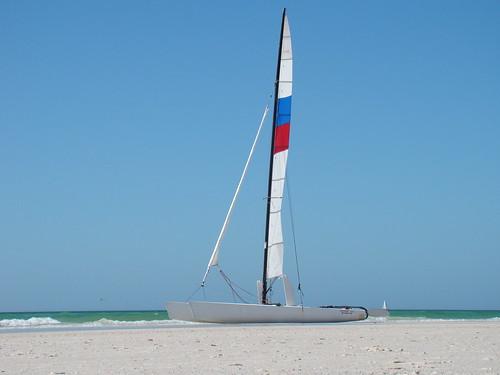 vacation beach sailboat boat sand paradise waves wind florida wave shore sail jib rudder blown tactical cataman