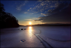 Icy Sunset (angus clyne) Tags: winter sunset ice broken scotland frozen sundown perthshire boring crack lee loch dunkeld filters setting locked cracked thaw lochs blairgowrie endless thawing flikcr endlesswinter lochoflowes