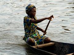 Elegante sur l'eau - Ganvi - Benin (Justinsoul) Tags: voyage africa leica trip travel lagune girl women flickr femme lac afrika benin paysage pays pirogue pais afrique   ganvi  vlux1 nokou  fluidr justinsoul