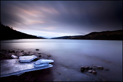 Melting - Loch Tummel (angus clyne) Tags: longexposure sunset ice rain rock scotland stream wind perthshire rocky wave spray stack pebble shore melt loch stacked slab drizzle gloaming flikcr tummel leefilters