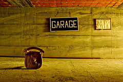 I swear I wont let go (Geraint Rowland Photography) Tags: lighting italy art sign store empty seat garage surreal spare livigne