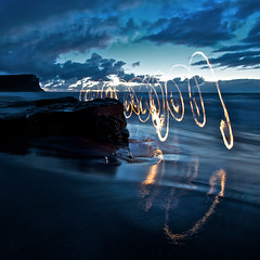 Garie Beach Fire Scribbles (alexkess) Tags: ocean park morning light wild sky seascape lightpainting art feet beach night clouds painting fire photography dawn early twilight sand nikon rocks long exposure flickr grafitti circles flames fine sydney royal halo australia running ring burning photoblog national nsw inferno shire alexander juggling pyro tobias sparks sutherland dreamscape garie natio firepainting d700 alexkess kesselaar lightpainters huenlich