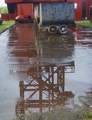 P5020005 (Jonathan Riverwalker) Tags: reflection tower reflections puddle essen mining frderturm ruhr ruhrgebiet zeche kray bonifacius