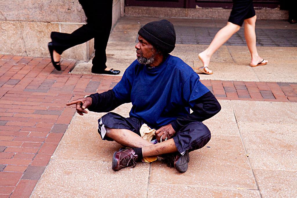 Man-on-ground-gesticulating--Center-City