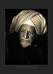 Old Eyes (Tharwat Al-Kyamy) Tags: bridge blue red portrait man film stone digital advertising photography photo al model paint acrylic action body pastel sony x photographic brush blow company photograph saudi arabia syria damascus mohammad hdr drowing  drow     a700 carbonized crocky tharwat  pancil     khober kyamy   khyamy