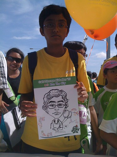 caricature live sketching for Cold Storage Kids Run 2010 - 8