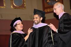 Zahid Ahmed hooded by Drs. Woolfolk & Heys