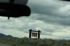 Entrance sign for Grand Teton National Park (Trevor.Huxham) Tags: wyoming signs grandteton grandtetonnationalpark clouds nationalpark canonef50mmf18ii canoneosrebelxs