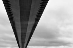 \ / ~ A Tribute (Esther Seijmonsbergen) Tags: uk longexposure bridge england detail closeup architecture mono vanishingpoint yorkshire tribute suspensionbridge humberbridge hessle estherseijmonsbergen wwwdigitalexposurephotographycom