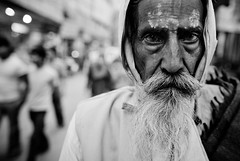 v  (falsalama) Tags: street portrait india photography 24mm baba sadhu moksha ahimsa asceticism sannyasin  sannyasi falsalama shramana danielgriffin 5dmk2  sannyasa pramit  nekkhamma renounciation