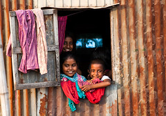 The Stranger is Family now [..Dhaka, Bangladesh..] (Catch the dream) Tags: light people house home window smile television childhood children tv afternoon happiness entertainment laugh actor dhaka household bangladesh corrugated afternoonlight olddhaka corrugatedtin gettyimagesbangladeshq2