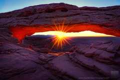 Solar Explosion - Mesa Arch, Canyonlands National Park, Utah (david.richter) Tags: morning summer usa mountain southwest nature rock stone sunrise canon landscape photography eos rebel dawn utah nationalpark twilight desert outdoor hiking unitedstatesofamerica crowd drop backpacking workshop greenriver blend xsi sunstar airporttower stoic mesaarch lasalmountains noclouds canyonlandsnp davidrichter 450d earlyrise washerwomanarch rebelxsi apertureacademy monstertower wwwdavidrichterphotographycom
