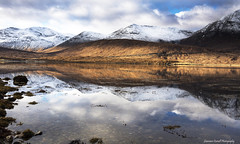 Time for some quiet reflection. (lawrencecornell25) Tags: landscape waterscape reflections lochannort scenery scotland skye isleofskye winter snow mountains nature outdoors cold nikond5