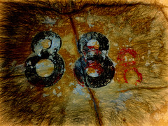 88 Remastered (Steve Taylor (Photography)) Tags: 88 stencil crack art digital black brown red paint newzealand nz southisland canterbury christchurch cbd city texture vigenette worn number