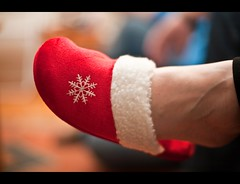So this is Christmas... (what_u_see_is not_what_u_get) Tags: snowflake christmas xmas red feet canon festive 50mm holidays dof bokeh f14 indoors canon5d slippers cosy christmasday yuletide sothisischristmas christmasday2009 ohwhatcosyfeetyouhave