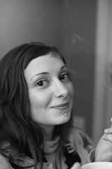 Kass ([expletive deleted]) Tags: friends portrait bigeyes blackwhite smoke newyearseve northvancouver labretpiercing portraitswithexpression