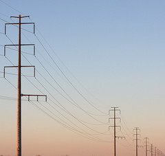 Rural electricity (kevin dooley) Tags: road county blue sky orange dusty electric rural canon 50mm vanishingpoint wire pattern power indian telephone 14 line pole diagonal explore powerlines creativecommons electricity roadside dust f56 setting electriccompany hung carwindow reservation parabola diminishing vp gilariver maricopa strung powercompany 40d technoscape ruralelectricity