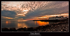 The Boat (Chaos2k) Tags: autumn sunset lake ontario canada nature water clouds photoshop canon rocks 1855 theboat 2009 efs xsi northbay nipissing allphotoswanted brianboudreau peregrino27newvision