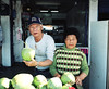 Betel nut chewing, coconut selling couple (deepstoat) Tags: portrait colour 120 film mediumformat coconut taiwan betelnut mamiya7ii kodakportra orangemouth deepstoat
